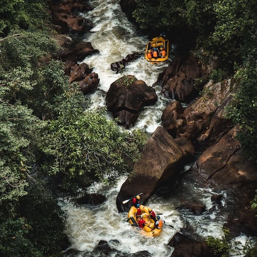 Two yellow tubes whitewater rafting in nature